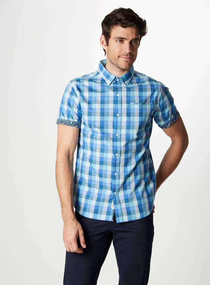 Short sleeve men's shirt in blue plaid pattern with floral sleeve cuff