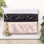 Women's clutch bag: Double zippers, shimmery rose gold, black and silver with large gold tassle